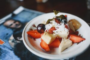 delicious fruit dessert with mint leaf on top